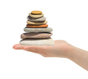 Stack of stones in hand Stock Images