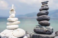 Stack of stones on the Hin nam beach, Lipe, Thailand.  Stock Photo