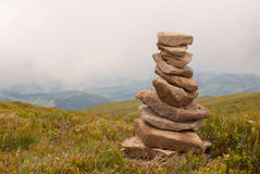 Stack of stones laying in the mountains Royalty Free Stock Images