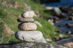 Stack of stones in mountain river zen relaxation Royalty Free Stock Images