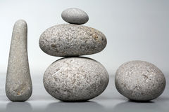 Stack of stones - pebbles on grey background Stock Image