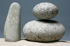 Stack of stones - pebbles on grey background Royalty Free Stock Photos
