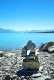 Stack stones at Pukaki lake. Stack stones in front of Pukaki lake in New Zealand Royalty Free Stock Photography
