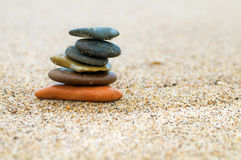 Stack of stones on sand Stock Photography