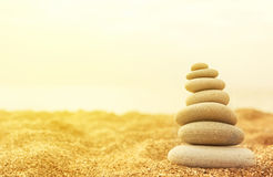 Stack of stones in the sand royalty free stock images
