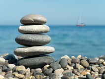 Stack of stones and yacht royalty free stock photography