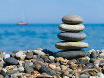 Stack of stones and yacht royalty free stock images