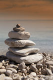 Stack of stones, Zen concept, on sandy beach Royalty Free Stock Photography