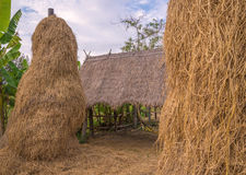stack of straw or hay bales in a rural landscape Stock Image