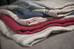Stack of Striped and Plain Cotton Linen of Various Colors Royalty Free Stock Photos