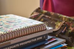 Stack of student books on desk stock photo