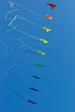 Stack of stunt kites. In rainbow colours. Tails are slightly blurred from fast movement Stock Image