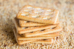 Stack of sugar cookies on chopped nuts Stock Photos