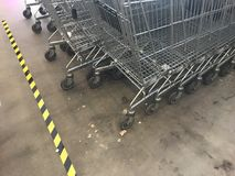 Supermarket metal trolleys stock image