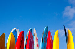 Stack of surfboards by seaside