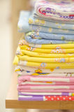 Stack of swaddling bands. Close-up of corner a laid colored laundry. Heap of folded linen of various colors. Royalty Free Stock Images