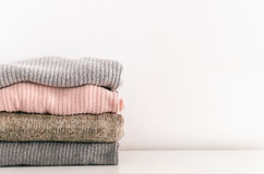 Stack of sweaters on white background. Copy space Stock Images