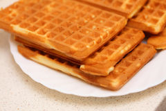 Stack of sweet belgian waffles on plate Royalty Free Stock Photo