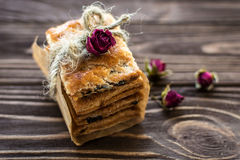 Stack of sweet crackers decorated with roses on rustic backgroun Stock Image