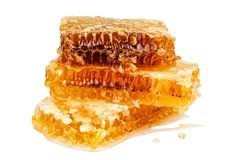 Stack of sweet and full honeycomb on white Stock Photography