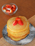 Stack of sweet pancakes with fresh strawberries and icing sugar Royalty Free Stock Image