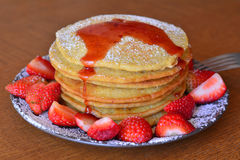 Stack of sweet pancakes with fresh strawberries and icing sugar Royalty Free Stock Images