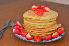 Stack of sweet pancakes with fresh strawberries and icing sugar Stock Photo