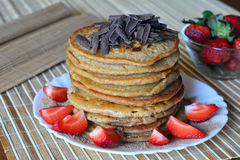 Stack of sweet pancakes with strawberries and chocolate Stock Images