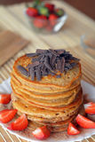 Stack of sweet pancakes with strawberries and chocolate Royalty Free Stock Images