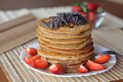 Stack of sweet pancakes with strawberries and chocolate Stock Image