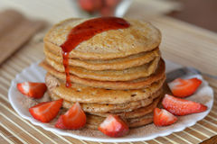 Stack of sweet pancakes with strawberries and syrup Stock Photo