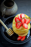 Stack of sweet pancakes with strawberry and honey. Gluten free flour Stock Image