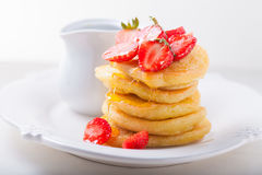 Stack of sweet pancakes with strawberry and honey. Stock Image