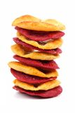 Stack of sweet potato and beet crisps isolated on white. Stack of sweet potato and beet crisps isolated on a white background Royalty Free Stock Image