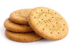Stack of sweetmeal digestive biscuits isolated on white. Royalty Free Stock Photo