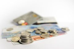 Stack of Swiss Coins and Bills Stock Photos
