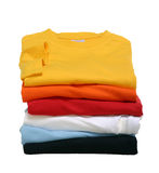 Stack of T-Shirts. A stack of t-shirts shot in the studio. The t-shirts are isolated in front of white background
