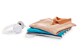 Stack of T-shirts and headphones Royalty Free Stock Image