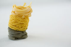 Stack of tagliatelle and capellini pasta. On white background Royalty Free Stock Photo
