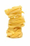 Stack of tagliatelle pasta nests. Over a white background royalty free stock photos