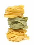 Stack of tagliatelle pasta nests Royalty Free Stock Images