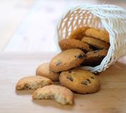Stack of tasty choc chip cookies on wooden table. Chocolate chips cookies on brown napkin royalty free stock images