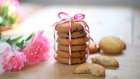 Stack of tasty choc chip cookies on wooden table. Chocolate chips cookies on brown napkin royalty free stock photos
