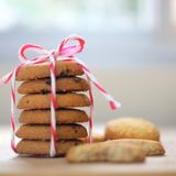 Stack of tasty choc chip cookies on wooden table. Chocolate chips cookies on brown napkin stock images