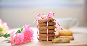 Stack of tasty choc chip cookies on wooden table stock photos