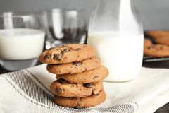 Stack of tasty chocolate chip cookies and milk. On table royalty free stock photo