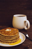 Stack of tasty pancakes with butter and honey for breakfast Royalty Free Stock Image