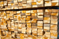 Stack of teak wood in lumber yard. pile Wooden. In sawmill stock photos