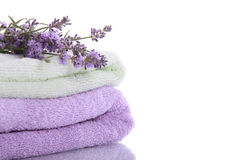 Stack of terry towels with lavender flowers royalty free stock photos