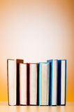 Stack of text books against gradient Royalty Free Stock Photography